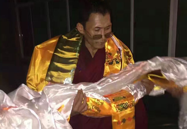 Lobsang Sangyal greeted after release from prison.