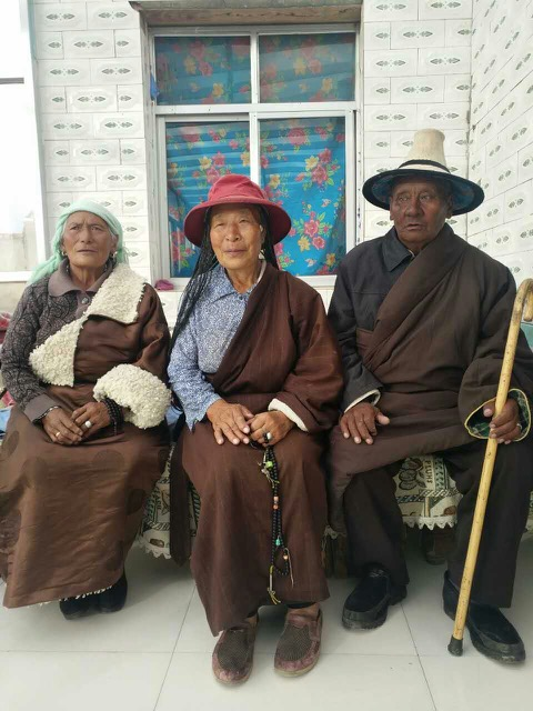 Tsegon Gyal's mother Tsewang Kyi (left), aunt (middle) and father Tselo (right)