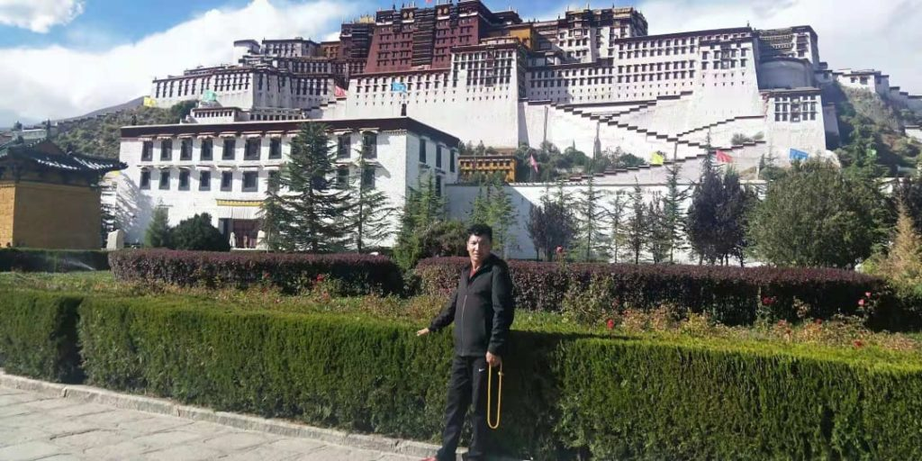 An undated photo of Lhadar on a pilgrimage trip to the Potala Palace in Lhasa.